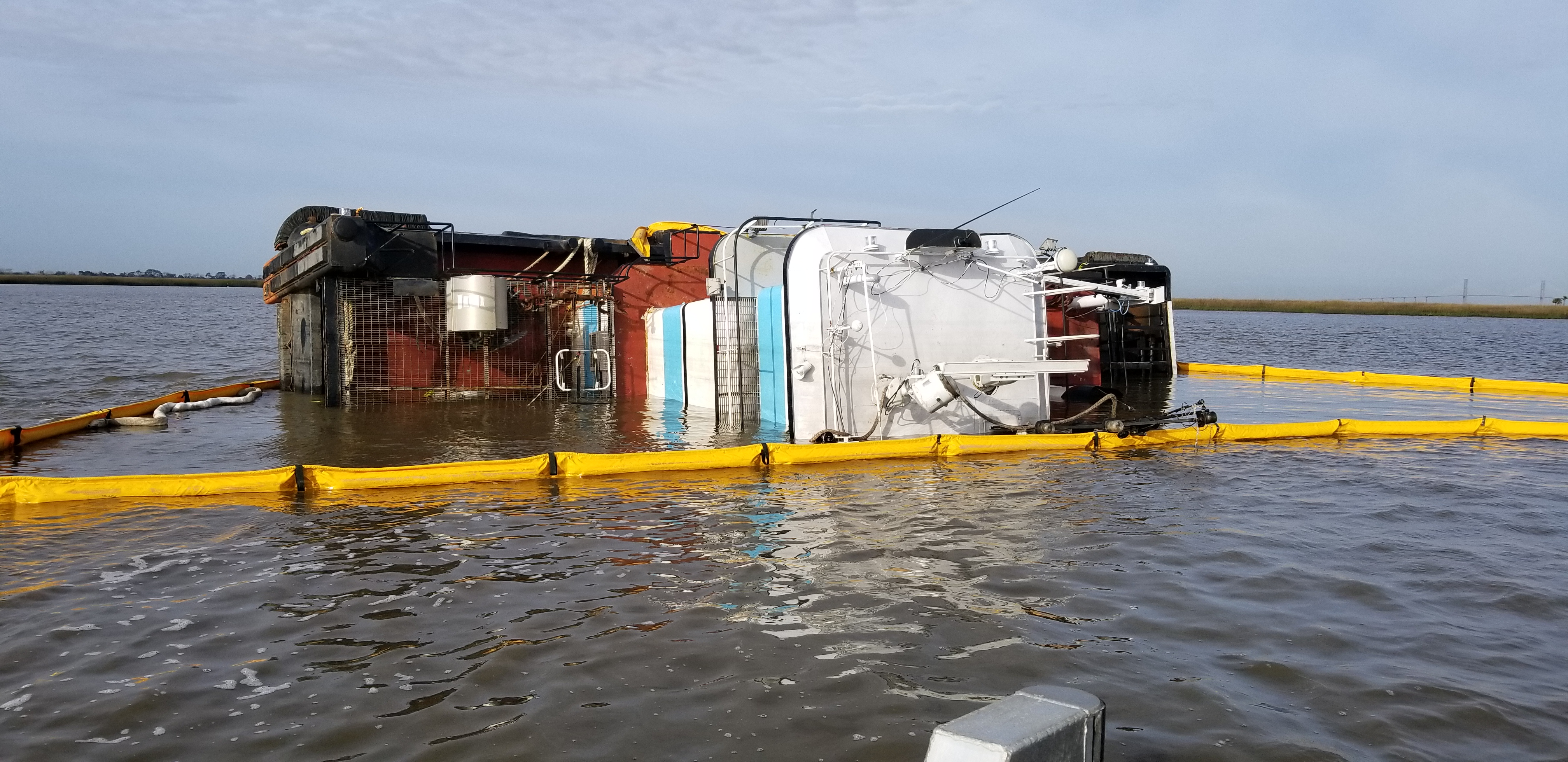 The Miss Addison, a 56-foot tug boat, is overturned on its port side in Jekyll Creek west of Jekyll Island, Ga., on Thursday, Jan. 3, 2019. Sam LaBarba/Georgia Department of Natural Resources.