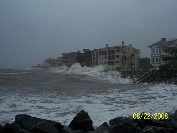 This photo illustrates storm waves from Tropical Storm Faye crashing on a hotel along the Georgia coast.