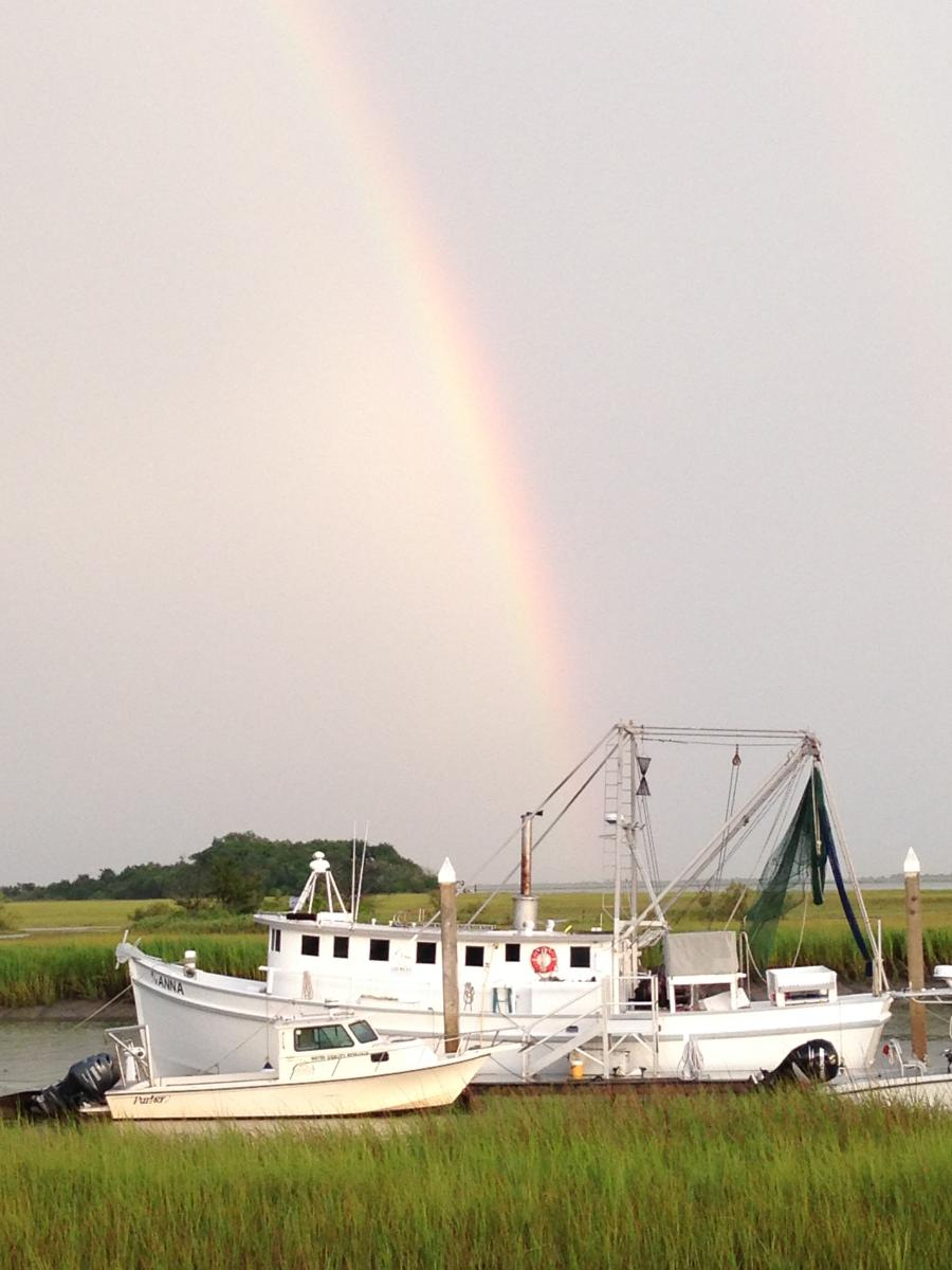 Photo of the Research Vessel Anna with a rainbow in the background