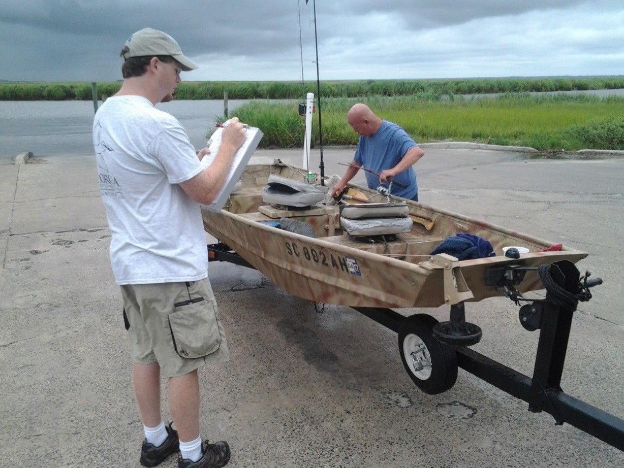 In this photo, a staff member from the Coastal Resources Division of the Georgia Department of Natural Resources interviews an angler as part of the annual Access Point Angler Intercept Survey.