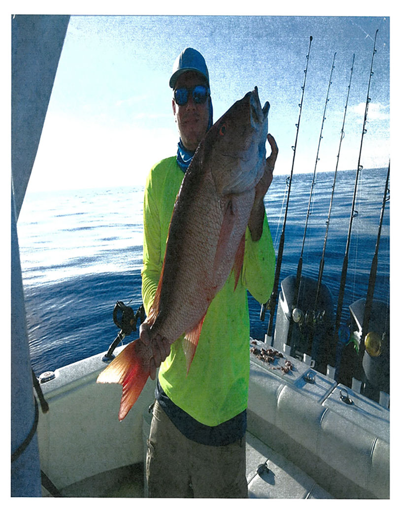 Benjamin Lewis with Mutton Snapper