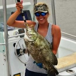 Angler holding a Tripletail